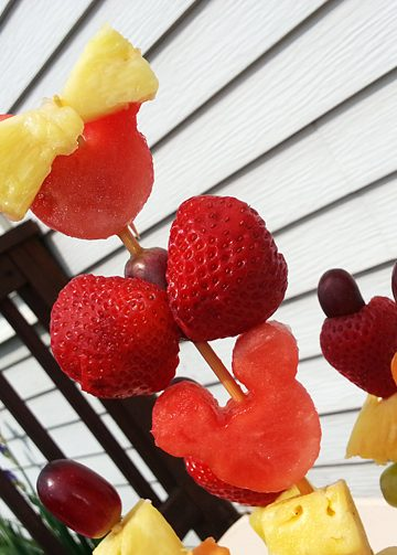 Minnie Mouse Fruit Skewers on Picnic Table